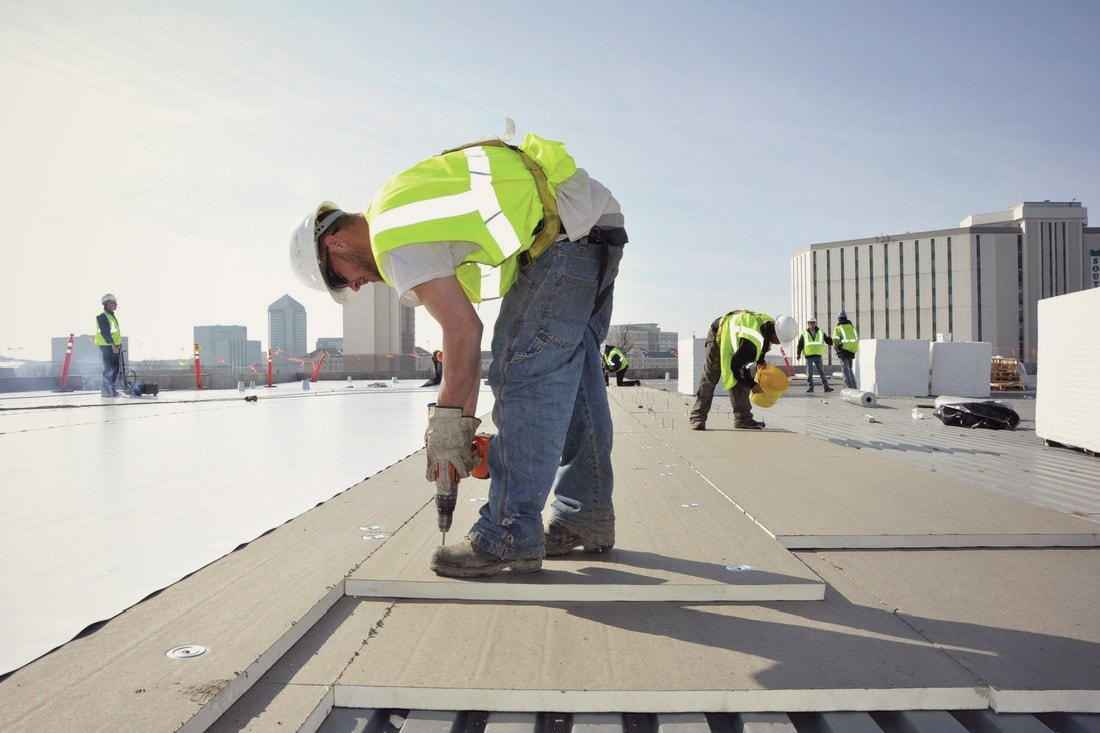 a roofing technician works on the commercial roof. What is the best commercial roof?